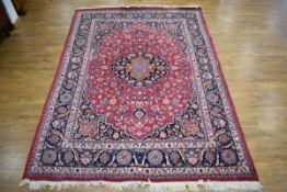 An Iranian carpet, the blue and floral ground within matching bands,