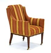 An Edwardian and later upholstered armchair with mahogany strung tapering legs on castors