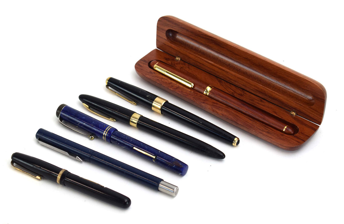 A Scheaffer fountain pen with a 14ct gold nib, two further pens with 14ct gold nibs,