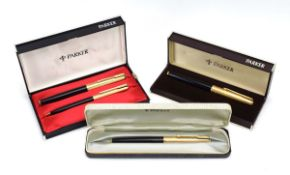 A cased Parker pen and pencil set with a 14ct gold nib,