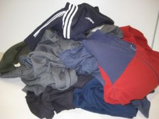 Bag containing mainly gents' jogging bottoms by Under Armour and Adidas together with Berghaus