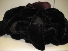 Bag containing 5 DKNY faux fur ladies hooded jackets, 4 in black and one in plum, sizes range from