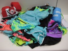 Bag containing Gerry girls swimming costumes in various sizes, designs and colours with 3 buoyancy