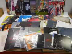 Box containing quantity of LP and 45 records to include Oscar Jerome, Kraftwerk, Pink Floyd, The Who