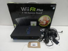 Sony Playstation 2 console with accessories and boxed Nintendo Balance board.
