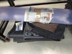 Large under bay of assorted matting incl. click together matting, office chair mat, door mats, car
