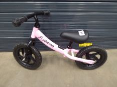 Small childs pink balance bike