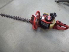 Shanks red petrol powered hedge cutter