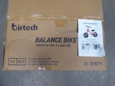 Boxed black childs' balance bike