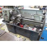 Colchester Master centre lathe with a grey and blue metal tool cabinet, two machine vices and a