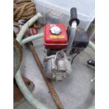 A petrol powered pump, hose and hand pump