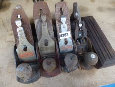 2 Stanley, 1 Acorn and 1 other plane and a sharpening stone