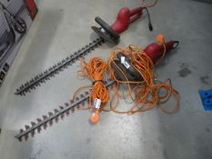2 red electric hedgecutters