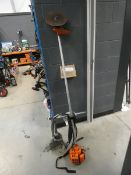 Echo SRM2300 petrol powered brush cutter