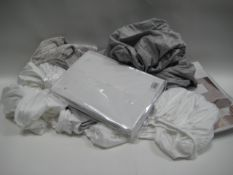 Bag containing various bed linen in various sizes and designs incl. fitted sheets, duvet covers,