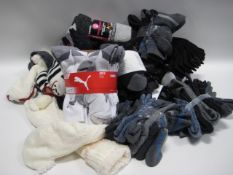 Bag of ladies and gents socks by Puma, Kirkland, Penguin and Weatherproof