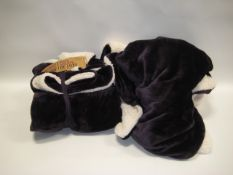 Bag containing 2 purple and cream coloured throws