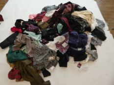 Half a stillage of ladies and men's clothing