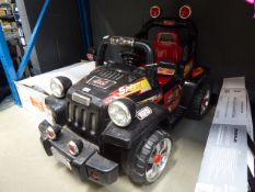 Black 4x4 electric jeep with charger