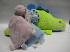 3 children's pillows, 1 as large blue and green dinosaur with rabbit and smaller blue dinosaur