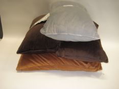 4 various pillows, 1 light brown, 2 dark brown and 1 grey (2 different sizes)