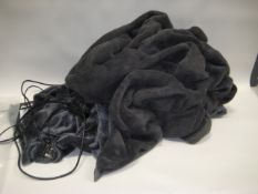 Bag containing large grey faux fur throw with bluey grey heated blanket