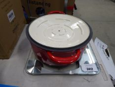 Weighing scale plus a red baking pot
