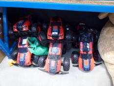 Large quantity of unboxed remote control trucks