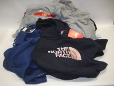 Bag containing ladies and gents jogging bottoms and hoodies in various sizes, colours and styles