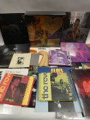 Box containing LP and 45 records to include Sigur Ros, AC/DC, Fleetwood Mac, Elvis and others
