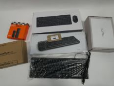 Bag containing 3 keyboards, Zgemma H9S media player, Fire TV Stick Lite, IQOS vape kit