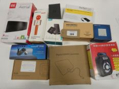 Bag containing aerials, wireless chargers, mini HiFi, adapters, etc