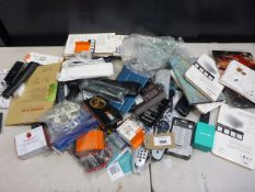 Bag containing various accessories; tablet cases, cables, remote controls, adapters, keys, board etc