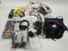Bag containing various headsets, earphones and earphone accessories