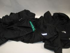 Three lightweight jackets by Columbia, Dewalt and Northface all in black