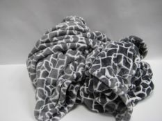 Two grey and white patterned throws
