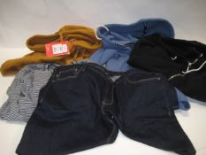 Bag containing North Face hoodie in mustard, 2 x Superdry hoodies in light blue and black, pair of