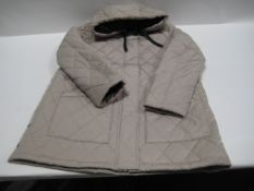 Box containing 16 weatherproof ladies quilted and hooded jackets in light beige