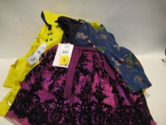 Bag of kids clothing to incl. yellow raincoats, party dress, small quantity of pyjama sets with