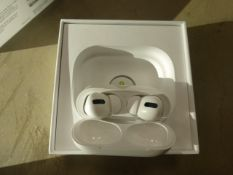 Apple AirPods Pro with wireless charging case and box