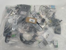 Bag containing remote controls, Tunstall Lifeline Vi/Vi+ telecare unit, adapters, mice etc