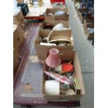 4 boxes containing table lamps, table tennis bats, placemats, dressing table set, mirror, handbag,