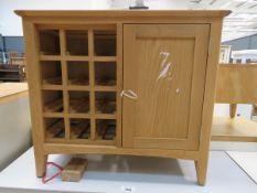 Oak sideboard with single cupboard door and wine bottle rack (50)