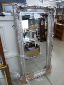 Rectangular bevelled mirror in silver painted frame (a/f)