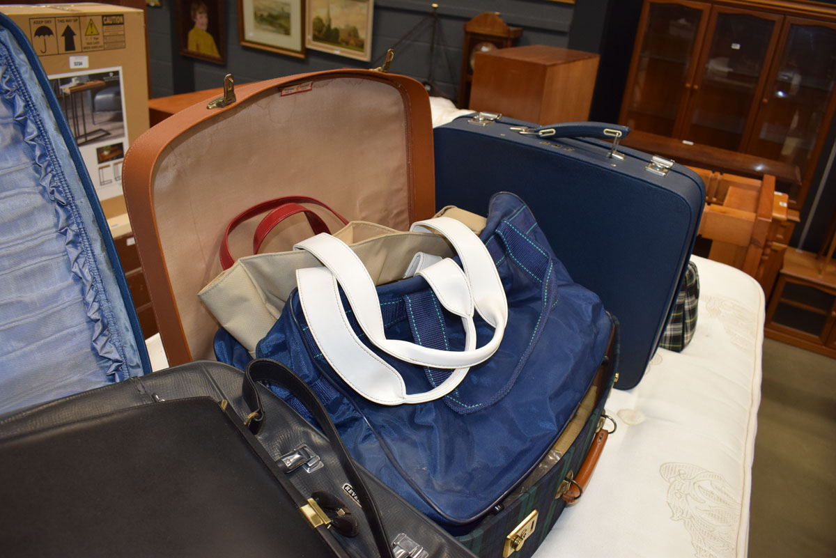 A quantity of travelling cases, handbags and other bags