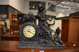 A modern quartz mantel clock by Juliana modelled as a female musician, w. 52 cm Working order