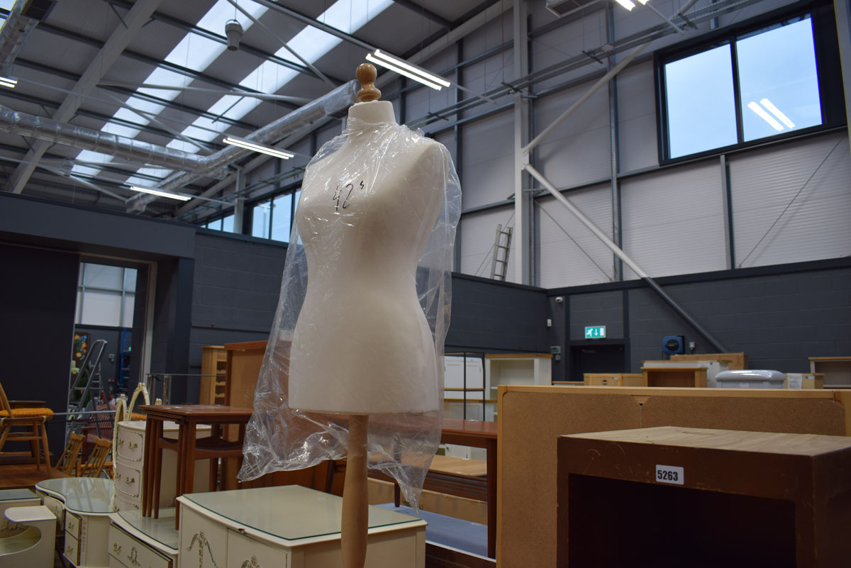 A modern cream fabric female mannequin