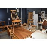 A set of four Ercol elm seated 'wishbone' kitchen chairs and a matching rectangular dining table