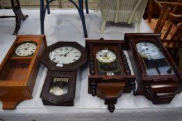 Four modern regulator type wall clocks
