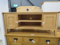 Mid size oak TV audio cabinet with 2 shelves and 2 single door cupboards
